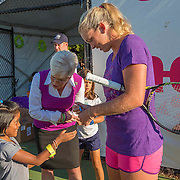 August 19, 2014, New Haven, CT:<br /> Connecticut Lieutenant Governor Nancy Wymanand Coco Vandeweghe sign autographs during a Girl Scout Night clinic on day five of the 2014 Connecticut Open at the Yale University Tennis Center in New Haven, Connecticut Tuesday, August 19, 2014.<br /> (Photo by Billie Weiss/Connecticut Open)