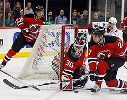 February 18, 2008; Newark, NJ, USA;  New Jersey Devils goalie Martin Brodeur (30) and New Jersey Devils defenseman Mike Mottau (27) defend against the Carolina Hurricanes during the first period at the Prudential Center in Newark, NJ.