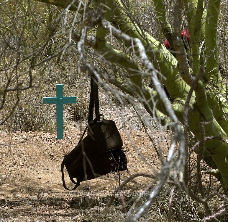 A cross marks the location where an 11-year-old girl, who crossed illegally into Arizona from Mexico, died from heat exhaustion and dehydration near Nolia on the Tohono O'odham Nation in the Sonoran Desert, USA.