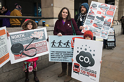 London, UK. 22 January, 2020. Elizabeth Cairns (c), author of 'The Empowered Entrepreneur' and Extinction Rebellion member, arrives in Westminster with other campaigners seeking to protect ancient woodland and wildlife threatened by the HS2 high-speed rail link to lobby their MPs to speak out against and push for an immediate halt to works for the huge infrastructure project. Cost projections for the project, which would destroy or irreparably damage 108 ancient woodlands, are reported to have risen to £106bn and the Government is expected to make a decision about its viability in February.