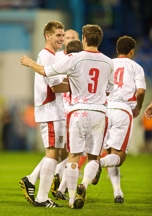 PODGORICA, MONTENEGRO - Wednesday, August 12, 2009: Wales' Sam Vokes celebrates scoring his side's first goal with Sam Ricketts against Montenegro during an international friendly match at the Gradski Stadion. (Photo by David Rawcliffe/Propaganda)