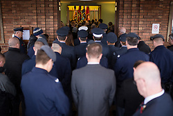 © Licensed to London News Pictures . 11/11/2012 . Lytham Park Crematorium , UK . Mourners outside the crematorium as the coffin is passed behind the curtain . Hundreds of strangers at the funeral of World War Two veteran Harold Jellicoe Percival today (Monday 11th November 2013) . The funeral is timed to coincide with the First World War armistice , the 95th anniversary of which is at 11am today (Monday 11th November 2013) . The RAF Bomber Command veteran died in his sleep on 25th October 2013 , aged 99 , at Alistre Lodge Nursing Home in St Annes , Lancashire , with no immediate family . Photo credit : Joel Goodman/LNP