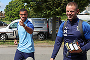 AFC Wimbledon striker Kweshi Appiah (9) and AFC Wimbledon fitness coach Jason Moriarty arriving during the EFL Sky Bet League 1 match between AFC Wimbledon and Accrington Stanley at the Cherry Red Records Stadium, Kingston, England on 17 August 2019.