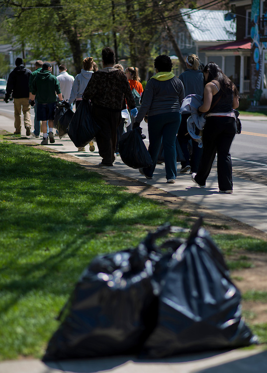 Ohio University student volunteers walk down Mill Street looking for trash to pick up during the Off Campus Living Fest Clean Up event Sunday, April 21, 2013. Students picked up trash long the sidewalks and grass to prevent trash build up after fest season came to a close for the school year with Palmer Fest, which was held the previous Saturday, April 20.