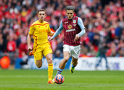 Jack Grealish of Aston Villa is challenged by Jordan Henderson of Liverpool - Photo mandatory by-line: Rogan Thomson/JMP - 07966 386802 - 19/04/2015 - SPORT - FOOTBALL - London, England - Wembley Stadium - Aston Villa v Liverpool - FA Cup Semi Final.