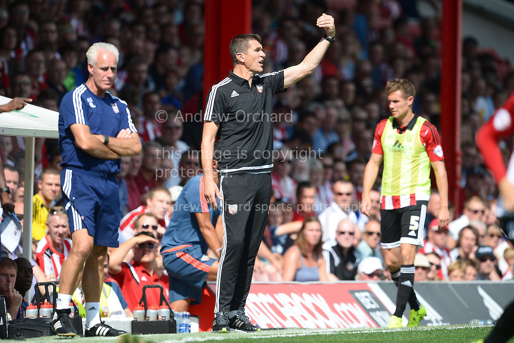 Marinus Dijkhuizen, the Brentford &copy; head coach giving directions to his players from the touchline. Skybet football league Championship match, Brentford v Ipswich Town at Griffin Park in London on Saturday 8th August 2015.<br /> pic by John Patrick Fletcher, Andrew Orchard sports photography.