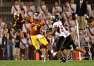 September 2 2010: Iowa State Cyclones quarterback Austen Arnaud (4) throws the ball while running away from two defenders during the second half of the NCAA football game between the Northern Illinois Huskies and the Iowa State Cyclones at Jack Trice Stadium in Ames, Iowa on Thursday September 2, 2010. Iowa State defeated Northern Illinois 27-10.