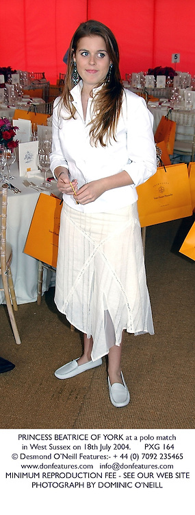 PRINCESS BEATRICE OF YORK at a polo match in West Sussex on 18th July 2004.PXG 164