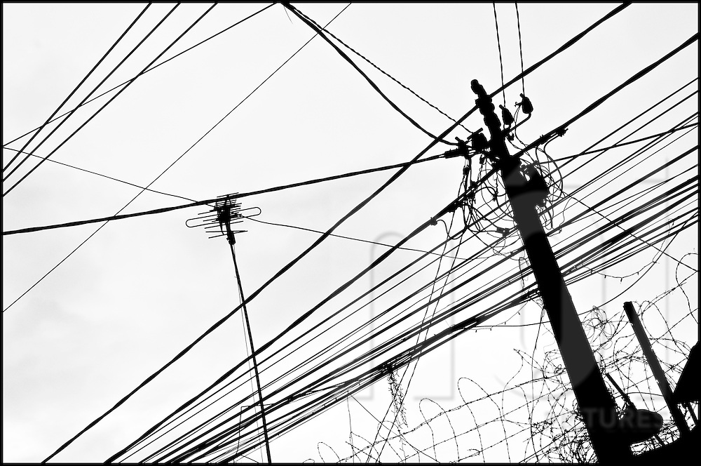 Electric wires net in a street of Ho Chi Minh city (HCMC), Vietnam, Asia.
