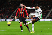 Alex Oxlade-Chamberlain (15) of Liverpool crosses the ball as Lewis Cook (16) of AFC Bournemouth watches on during the Premier League match between Bournemouth and Liverpool at the Vitality Stadium, Bournemouth, England on 7 December 2019.