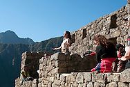 A sun worshipper comes to give thanks and praise to the sun during the winter solstice at Machu Picchu.  The Incas believe that the god of the sun was named Inti and was considered the giver of life.