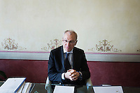 SIENA, ITALY - 20 MARCH 2015:  Marcello Clarich (57), President of the Monte dei Paschi di Siena Foundation, is interviewed at Palazzo Sansedoni (headquarters of the foundation) in Siena, Italy, on March 20th 2015. <br /> <br /> The charitable Monte dei Paschi di Siena Foundation is the bank's largest shareholder that has financed projects in the fields of economic development, art and research. Until 2014, the Foundation has entirely funded Siena Biotech, a clinical-stage drug discovery company whose  efforts are mainly focused on discovering new drugs for therapeutic intervention against neurodegenerative diseases and in oncology, such as Alzheimer&rsquo;s Disease, Huntington&rsquo;s Disease and Cancer.<br /> <br /> Now Siena Biotech has filed for bankruptcy proceedings, and its researchers and employees occupied the headquarters of the company based in Siena.<br /> <br /> Siena, a Tuscan city and UNESCO World Heritage Site, is home to Monte dei Paschi di Siena, the world's oldest surviving bank and Italy's third largest bank. The bank, founded in 1472, was the largest employer in Siena, and it helped finance a host of community projects and services until it stumbled during the financial crisis started in 2008.