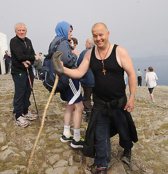 Pat Laurence from Ballina on the summit of roagh Patrick for the annual pilgrimage.Pic Conor McKeown