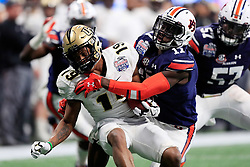 UCF Knights quarterback Sean Pratt (19) is tackled by Auburn Tigers wide receiver Marquis McClain (17) during the 2018 Chick-fil-A Peach Bowl NCAA football game on Monday, January 1, 2018 in Atlanta. (Paul Abell / Abell Images for the Chick-fil-A Peach Bowl)