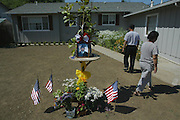 The parents of Thai Vue leave a memorial set up in front of their home (left) Chon Vue and Chia Thao the mother.  Spc. Thai Vue was killed in Baghdad when a mortar round hit his motor pool. Vue was the third son of six children born to his father, Chou Vue, and mother, Chia Thao. The family lives in Willows, California.  Picture taken Tuesday, June 22, 2004.