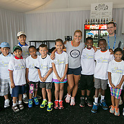 August 15, 2014, New Haven, CT:<br /> Dominika Cibulkova poses for a photograph with kids from the New HYTEs youth development organization during the draw ceremony at the 2014 Connecticut Open at the Yale University Tennis Center in New Haven, Connecticut Friday, August 15, 2014.<br /> (Photo by Billie Weiss/Connecticut Open)