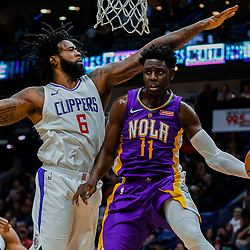 Jan 28, 2018; New Orleans, LA, USA; New Orleans Pelicans guard Jrue Holiday (11) passes as LA Clippers forward Montrezl Harrell (5) defends during the fourth quarter at the Smoothie King Center. The Clippers defeated the Pelicans 112-103. Mandatory Credit: Derick E. Hingle-USA TODAY Sports