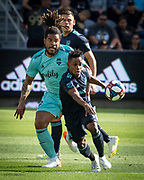 LAFC forward Latif Blessing (7) gets past Seattle Sounders defender Roman Torres (29) during a MLS soccer match in Los Angeles, Sunday, April 21, 2019. LAFC defeated the Sounders 4-1. (Ed Ruvalcaba/Image of Sport)