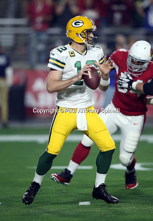 Green Bay Packers quarterback Aaron Rodgers (12) is pressured by Arizona Cardinals linebacker Zack Wagenmann (94) as he looks to pass during the NFL NFC Divisional round playoff football game against the Arizona Cardinals on Saturday, Jan. 16, 2016 in Glendale, Ariz. The Cardinals won the game in overtime 26-20. (©Paul Anthony Spinelli)