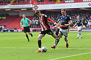 Sheffield United midfielder David Brooks (36) and Millwall FC midfielder Jed Wallace (14) during the EFL Sky Bet Championship match between Sheffield United and Millwall at Bramall Lane, Sheffield, England on 14 April 2018. Picture by Ian Lyall.