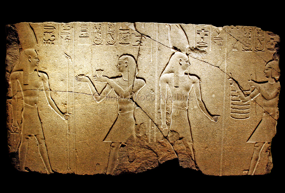 Nectanebo 11 offers to Osiris Hemag. 30 Dynasty, reign 360-343 BC.  Granite. From Behbeit el Hagar.  Nectanebo 11 was only able to complete the decoration of the chapel for Osiris Hemag that stood on the roof of the temple.