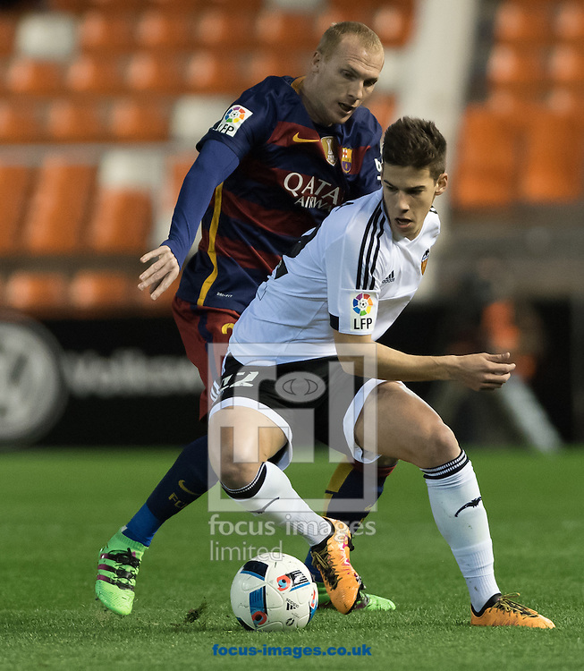 Santi Mina of Valencia Club de F&uacute;tbol and  Mathieu of FC Barcelona during the Copa Del Rey match at Mestalla, Valencia<br /> Picture by Maria Jose Segovia/Focus Images Ltd +34 660052291<br /> 10/02/2016