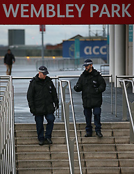 © Licensed to London News Pictures. 18/11/2015. London, UK Policemen patrol outside Wembley Stadium ahead of the England v France football match. Photo credit: Peter Macdiarmid/LNP