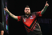 Michael Smith celebrates getting a draw during the PDC Premier League Darts at Arena Birmingham, Birmingham, United Kingdom on 25 April 2019.