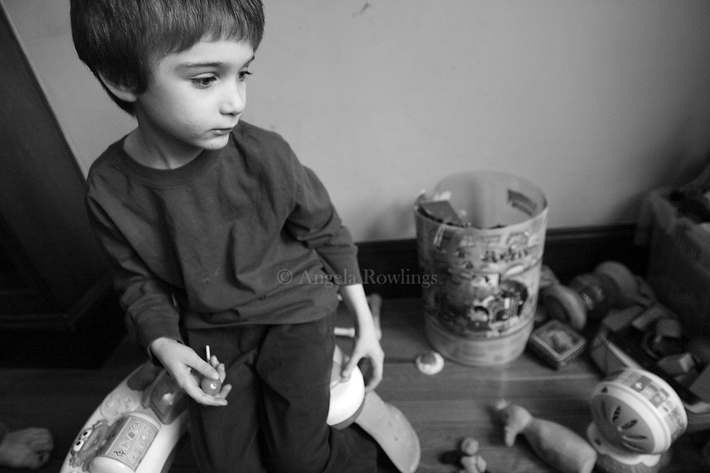 Aidan Sumner, 4, sits among his toys, Wednesday,  January 30, 2008.  Aidan, who has lead poisoning, and his family are being evicted from their Roslindale home where he contracted the lead poisoning.