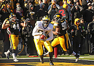 November 23 2013: Michigan Wolverines tight end A.J. Williams (84) pulls in a 2 yard touchdown reception during the second quarter of the NCAA football game between the Michigan Wolverines and the Iowa Hawkeyes at Kinnick Stadium in Iowa City, Iowa on November 23, 2013. Iowa defeated Michigan 24-21.