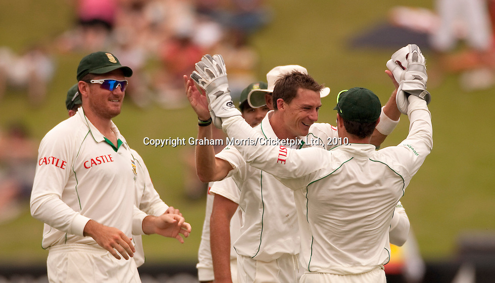 Bowler Dale Steyn (bareheaded) celebrates during the fourth and final Test Match between South Africa and England at the Wanderers Stadium, Johannesburg. Photograph © Graham Morris/cricketpix.com (Tel: +44 (0)20 8969 4192; Email: sales@cricketpix.com)