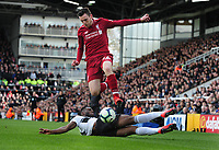 Football - 2018 / 2019 Premier League - Fulham vs. Liverpool<br /> <br /> Andrew Robertson of Liverpool is challenged by Timothy Fosu - Mensah of Fulhan, at Craven Cottage<br /> <br /> COLORSPORT/ANDREW COWIE