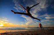 CAPE TOWN, SOUTH AFRICA - Friday 30 December 2016, a young girl does dance split jumps as the sun sets over Bikini Beach in Gordons Bay, a town 60km from Cape Town central in the Western Cape Province. (Photo by Roger Sedres/ImageSA)