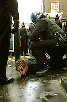 Youth being arrested by riot police during skirmish on the evening of Mayday events, London 2002.