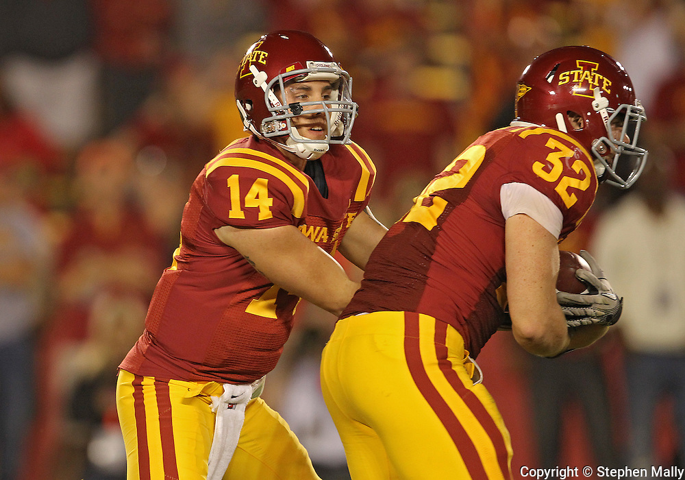 October 9 2010: Iowa State Cyclones quarterback James Capello (14) hands the ball off to Iowa State Cyclones running back Jeff Woody (32) during the second half of the NCAA football game between the Utah Utes and the Iowa State Cyclones at Jack Trice Stadium in Ames, Iowa on Saturday October 9, 2010. Utah defeated Iowa State 68-27.