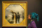 Peace: Burial at sea, Square paintings -The EY Exhibition: Late Turner – Painting Set Free - the first exhibition to survey Turner's final period of work (1835-51). From the age of 60 until his death. Highlights include: his 'radical' square oil paintings (pictured) in recently restored frames - at the time of their creation, these works were his most controversial and were famously subjected to a hail of abuse in the press; Bamborough Castle c.1837 – an important work from a private collection which has only been displayed in public once in 125 years; Ancient Rome and Modern Rome c.1839 – brought together for the first time in a generation; and Turner's three final masterpieces shown in newly reconstructed frames: Mercury Sent to Admonish Aeneas, The Visit to the Tomb and The Departure of the Fleet c.1850. The show runs from 10 Sept to 25 January. Tate Britain, London, UK, 08 Sept 2014.