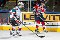KELOWNA, CANADA - MARCH 23: Jessey Astles #41 of the Tri-City Americans makes a pass over Tyrell Goulbourne #12 of the Kelowna Rockets on March 23, 2014 at Prospera Place in Kelowna, British Columbia, Canada.   (Photo by Marissa Baecker/Shoot the Breeze)  *** Local Caption *** Jessey Astles; Tyrell Goulbourne;