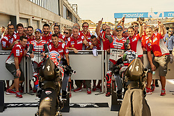 September 22, 2018 - Alcaniz, Teruel, Spain - Andrea Dovizioso (4) of Italy and Jorge Lorenzo (99) of Spain and Ducati Team celebrates whit his teammates after qualifying for the Gran Premio Movistar de Aragon of world championship of MotoGP at Motorland Aragon Circuit on September 22, 2018 in Alcaniz, Spain. (Credit Image: © Jose Breton/NurPhoto/ZUMA Press)