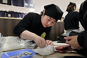 young woman cashier in department store in Japan
