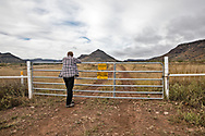Mark Glover at the entrance to a Trans-Pecos pipeline transfer station in Alpine Texas.