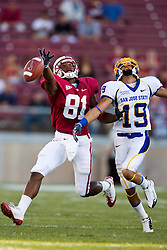 September 19, 2009; Stanford, CA, USA;  Stanford Cardinal wide receiver Chris Owusu (81) reaches for a pass over San Jose State Spartans cornerback Peyton Thompson (19) in the first quarter of the game at Stanford Stadium.