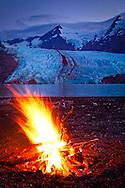 Close up of campfire in front of Portage Glacier at dusk, Chugach National Forest, Kenai Peninsula, Southcentral Alaska, Summer.