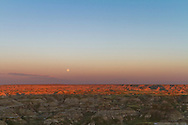 """Moonrise the day before Full Moon, over the badlands of Dinosaur Provincial Park, Alberta on August 23, 2010. Taken from the """"top of the hill"""" viewpoint at the entrance to the Park. Taken with a Canon 7D and 16-35mm lens at 32mm and ISO 100. Exposure metered. Still is a frame from a 750-frame time-lapse sequence."""