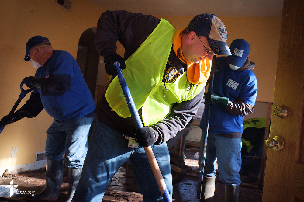 The Rev. Bart Day, executive director in the LCMS Office of National Mission, works with other volunteers from the International Center of The Lutheran Church–Missouri Synod, LCMS Disaster Response, New Beginnings Lutheran Church in Pacific, Mo., and Missouri representatives of the Southern Baptist Convention Disaster Relief, during a cleaning event at a flooded home in Fenton on Thursday, Jan. 14, 2016. LCMS Communications/Erik M. Lunsford