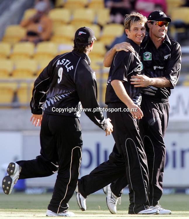 Shane Bond celebrates with Nathan Astle and Stephen Fleming after dismissing Chris Ganga during the 1st ODI cricket match between the West Indies and the New Zealand Black Caps at Westpac Stadium, Wellington, New Zealand, Saturday, February 18 2006. New Zealand won the match by 81 runs. Photo: Hannah Johnston/PHOTOSPORT<br />