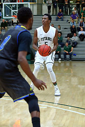 07 December 2016:  Jaylen Beasley looks for a 3 pointer during an NCAA men's division 3 CCIW basketball game between the North Park Vikings and the Illinois Wesleyan Titans in Shirk Center, Bloomington IL