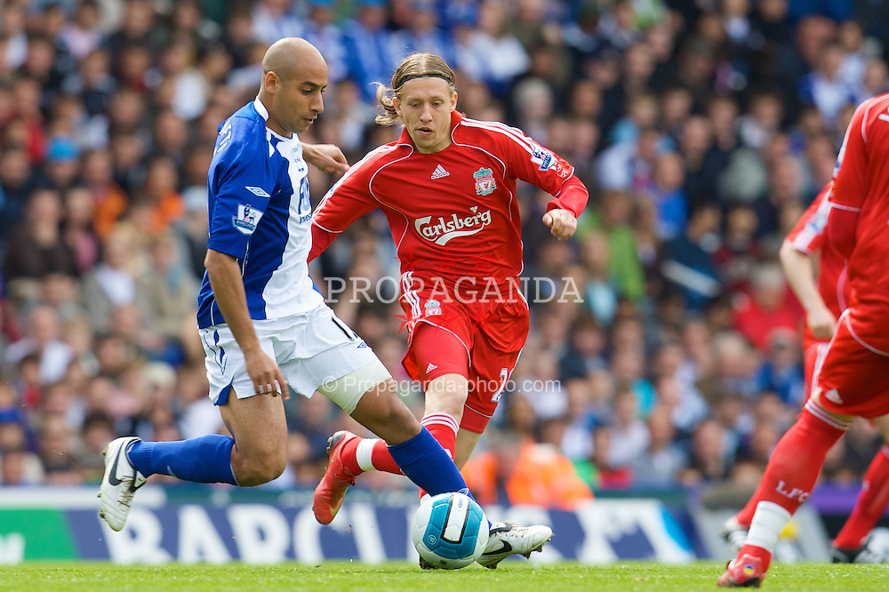 BIRMINGHAM, ENGLAND - Saturday, April 26, 2008: Liverpool's Lucas Levia and Birmingham City's Mehdi Nafti during the Premiership match at St Andrews. (Photo by David Rawcliffe/Propaganda)