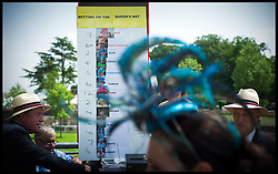 Bookmakers take bets on the colour of the Queen's hat at Royal Ascot Day 2-Racing Fans<br /> Ascot, United Kingdom<br /> Wednesday, 19th June 2013<br /> Picture by Andrew Parsons / i-Images