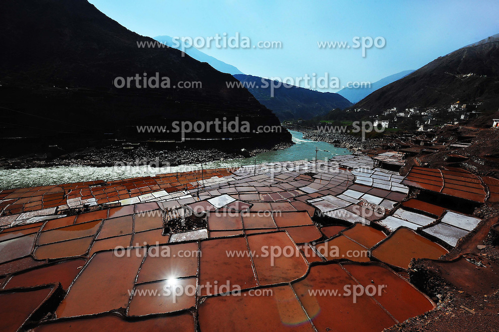 Photo taken on March 21, 2015 shows the salt pans in Markam County, southwest China's Tibet Autonomous Region. Markam county, with rich salt resources, has more than 3,000 salt pans to evaporate brine in the sun with an ancestral technique since Tang Dynasty (618-907AD), which is also the oldest method of salt production. This salt evaporation method was listed as one of China's National Intangible Cultural Heritage in 2009. EXPA Pictures &copy; 2015, PhotoCredit: EXPA/ Photoshot/ Wen Tao<br /> <br /> *****ATTENTION - for AUT, SLO, CRO, SRB, BIH, MAZ only*****