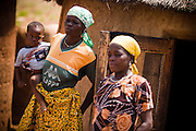 Woman and her child in their family compound in the village of Wantugu, northern Ghana, during a national polio immunization exercise on Friday March 27, 2009.
